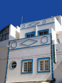 White Front of House with blue Ave Maria detail